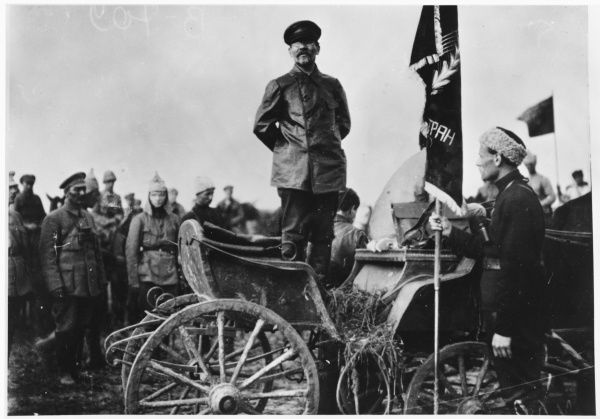 MIKHAIL IVANOVICH KALININ Russian politician presenting a banner to a Red Army regiment in 1920
