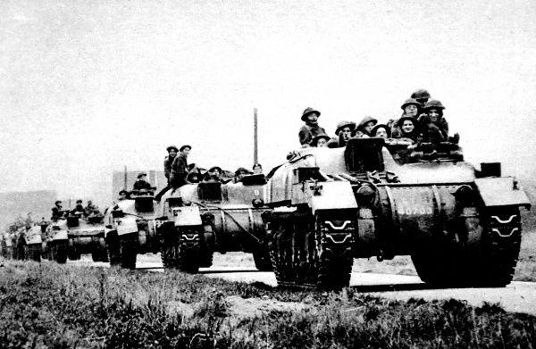 Photograph showing 'Kangaroo' armoured vehicles of the British Second Army moving through Holland on the way to the front line, December 1944
