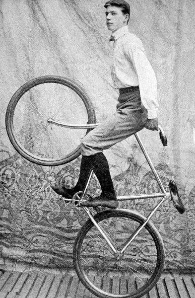Photograph of one of the Kaufmann troupe performing a bicycle trick at the London Hippodrome, September 1901