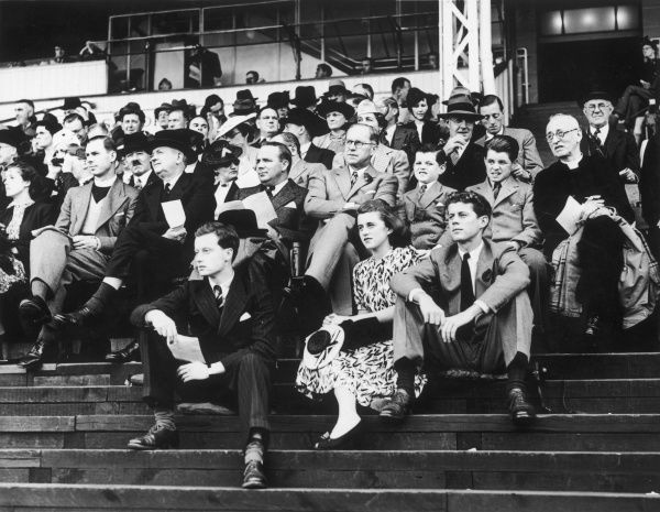 The American Ambassador, Joseph P. Kennedy with his children at the International University Athletics match at White City Stadium between Oxford and Cambridge vs. Harvard and Yale. Oxford and Cambridge won by 9 events to 3