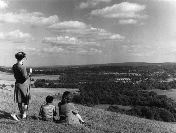 Ramblers admiring the view at Crockham Hill Common, Kent, England. Here can be seen mile after mile of the Kentish Weald, right to the forest ridges about Crowborough. Date: late 1930s