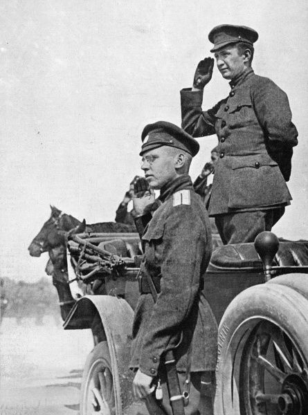 Kerensky, with one of his officers, takes a salute : he has formed a provisional government, but he will in turn be overthrown by the Bolsheviks