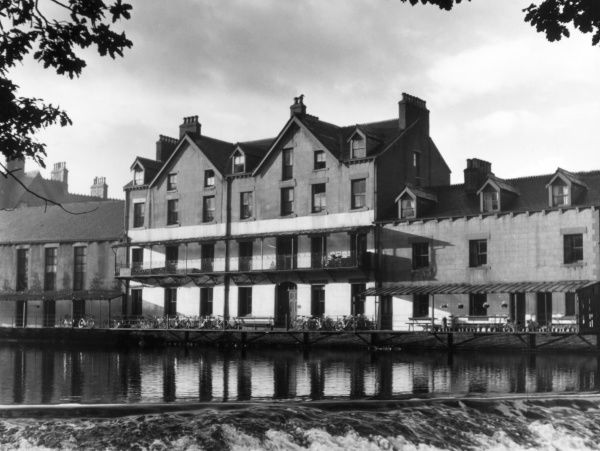 The fine Youth Hostel at Keswick, Cumbria, England, with many bicyles parked outside. Date: 1950s