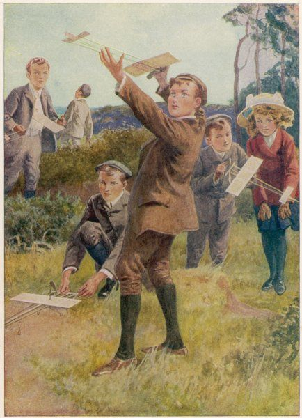 Children fly their model aeroplanes, powered by the unwinding of a rubber band which drives a propeller