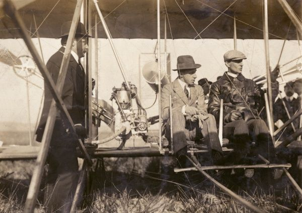 Wilbur Wright showing his plane to King Alfonso XIII of Spain at the Ecole d'Aviation, Pau, France