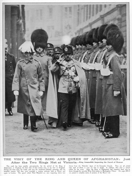 KING AMANULLAH OF AFGHANISTAN saluting as he inspects the Guard of Honour in place to welcome him to Victoria station in London during a visit in 1928