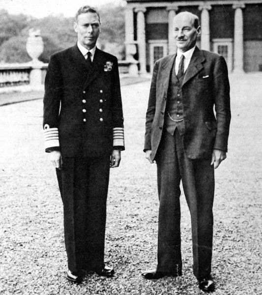 Photograph of King George VI (1895-1952) and Clement Attlee, 1st Earl Attlee, (1883-1967) in the grounds of Buckingham Palace, 1945. Attlee had just led the Labour Party to victory in the General Election and thus become Prime Minister