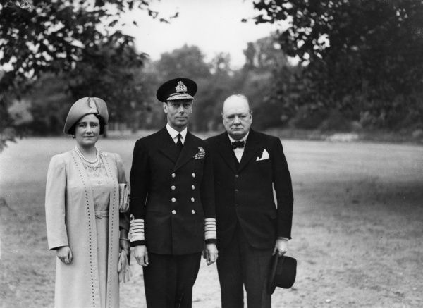 Wartime British Prime Minister, Winston Churchill photographed with King George VI and Queen Elizabeth at Buckingham Palace in September 1940 after the Palace had been damaged by German bombs during the Blitz