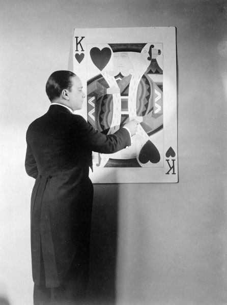 Vincent Lopez (1895 - 1975), American band leader and pianist, seen here taking part in some kind of card trick involving the King of Hearts. Date: early 1930s