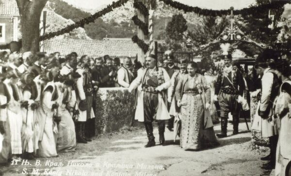 King Nikola I of Montenegro (wearing a rather splendid pointed hat) and Queen Milena Vukotic at a ceremonial rural pageant Date: circa 1912