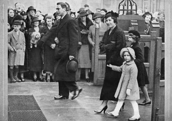 King George VI and Queen Elizabeth enter the gates of St. Mary's Church, Eastbourne. They are accompanied by their daughters, Princess Elizabeth and Princess Margaret