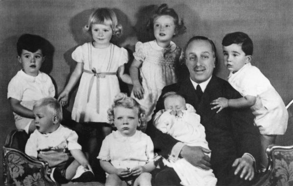 Infante Juan Carlos of Spain (now King Juan Carlos) shown bottom left, looking out of the picture, appearing with his grandfather, sisters and cousins in April 1939: from the left, Don Alfonso (son of Infante Jaime), Infante Juan Carlos (son of Infante Juan)