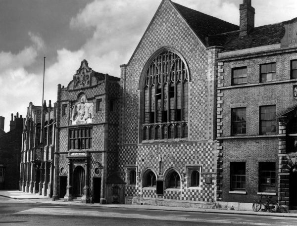 The ancient Guildhall, King's Lynn, Norfolk, England. An earlier building burned down in 1421. The facade is a splendid white stone and black flint chequered effect. Date: built 1423