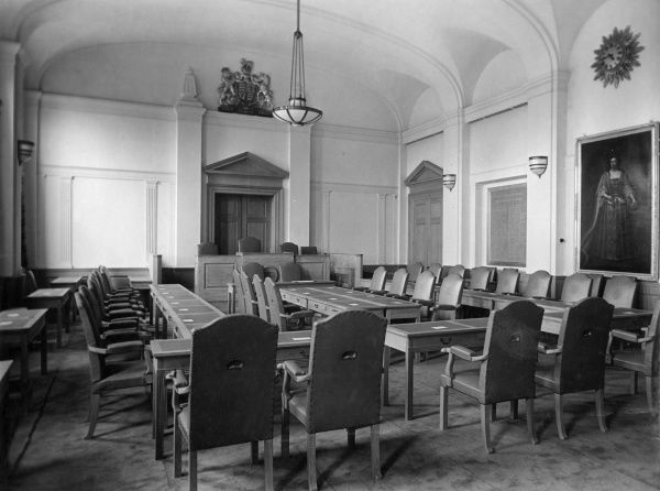 Tables and chairs in the Council Chamber of the Guildhall, Kingston-upon- Thames, Surrey, England. Date: early 1940s