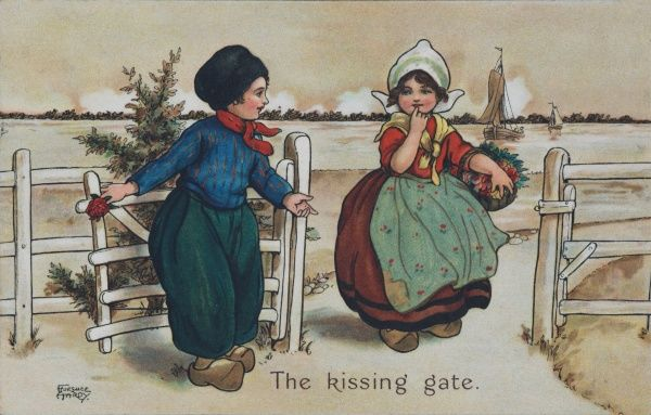 The kissing gate. Two dutch children standing at the kissing gate