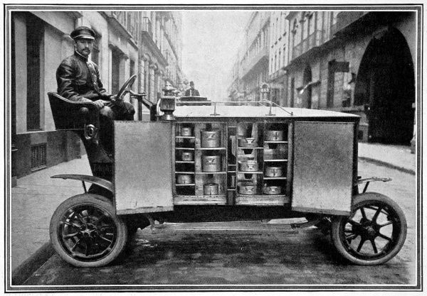 An eight horse-power car used to transport piping hot meals from a well-known Parisian restaurant to people in their homes
