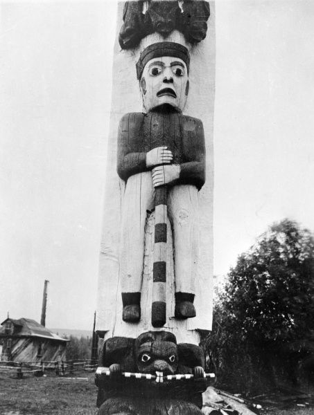 A totem pole at Kitwanga, British Columbia, Canada. Date: early 1930s