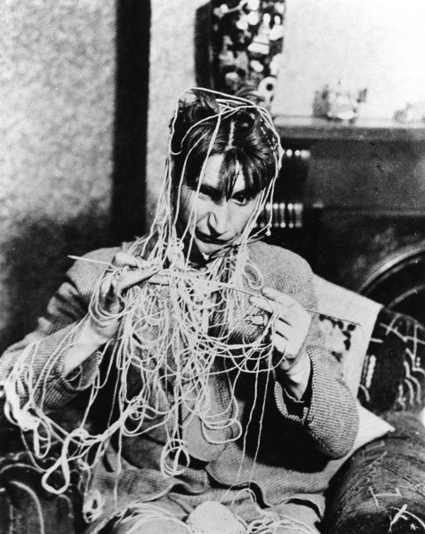 No this silly man is not covered in spaghetti, he is learning to knit! Date: 1930s