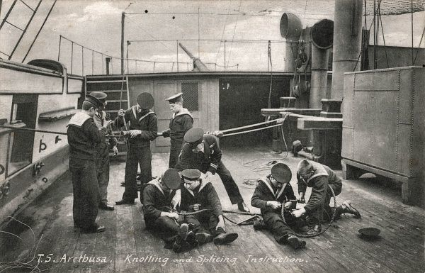 A group of boys aboard the Training Ship Arethusa receiving knotting and splicing instruction