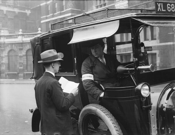 A London taxi driver (note the 'for hire' sign) gives directions to a lost gentleman, perhaps a foreign tourist. Drivers armband reads 'Je parle Francais&#39