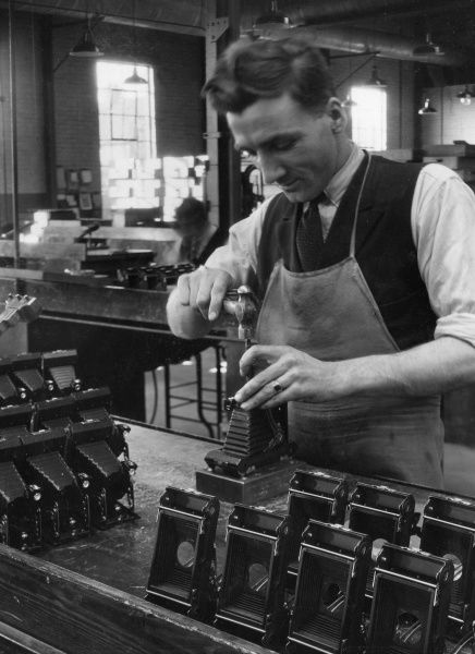 Putting the finishing touches to Kodak cameras. Date: 1930s