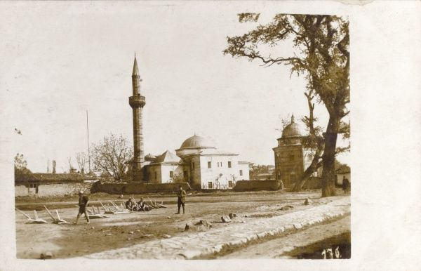 The Mosque of Sultan Mehmed Fatih, Pristina - one of the oldest monuments in Kosovo. One of the men in the foreground is wearing Albanian headgear. Date: 1910