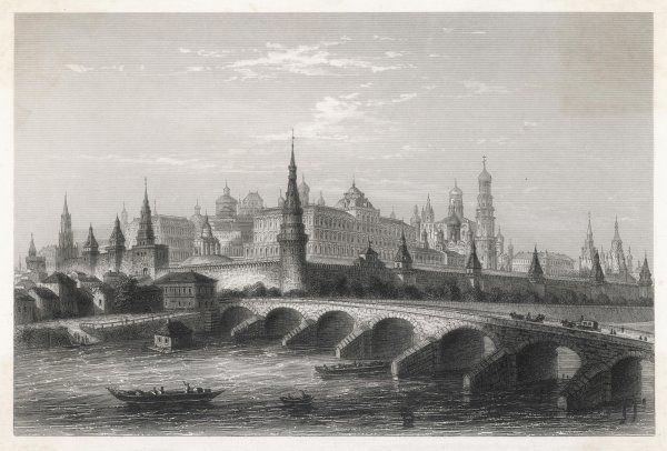A view of the Kremlin from the River Moskva with a stone bridge in the foreground