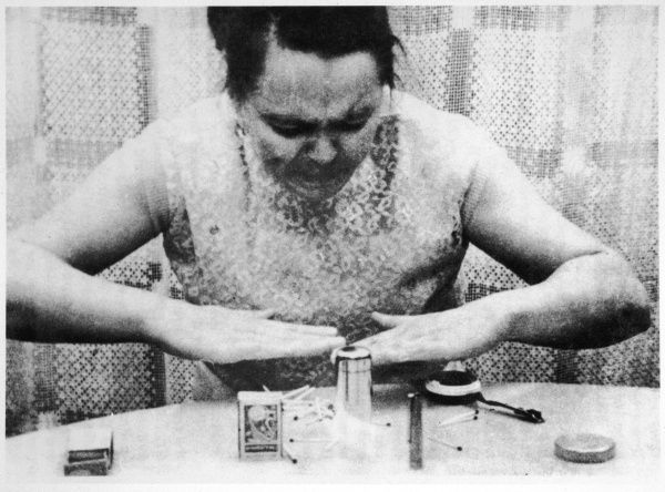 Nina KULAGINA, Russian 'psychic' attempts to raise an object from the table, by using her psychokinetic ability