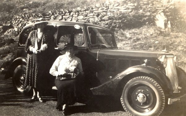 Two ladies and their Armstrong Siddeley car parked at the roadside