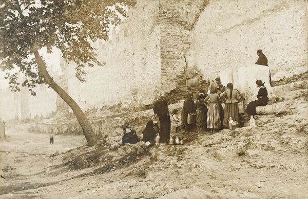 Women collecting water in their water bottles/jars at a fountain in Istanbul, located just outside the city walls