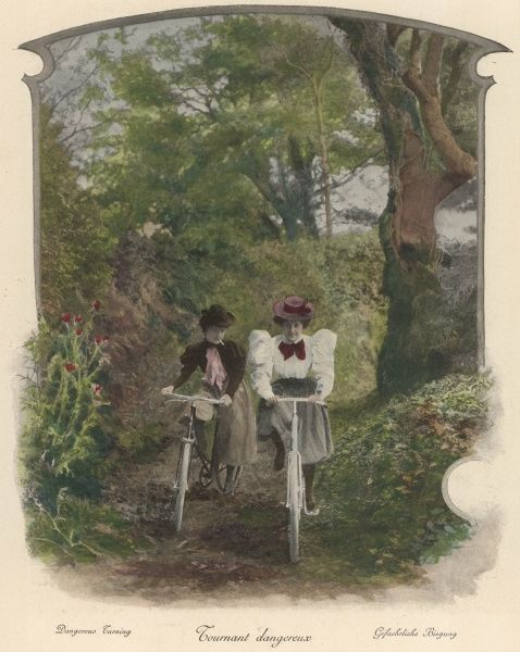 Two ladies cycling through a wood