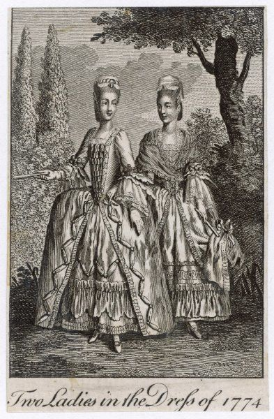 Two ladies walk in the garden wearing the fashionable dress for the year - the one on the right seems to have an implement for raising her long skirt if the path is muddy