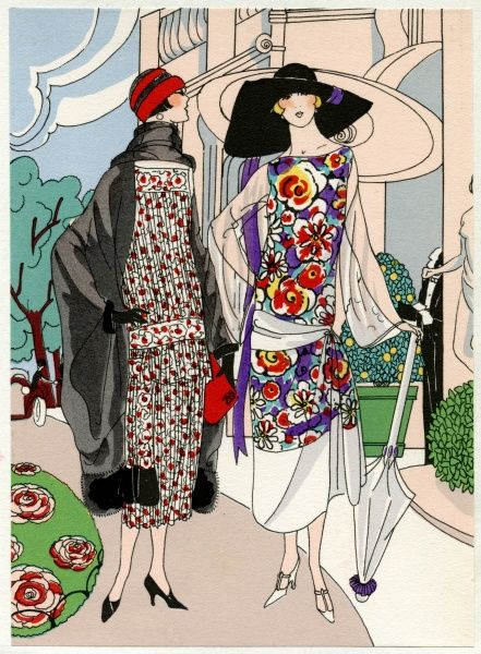 Two ladies in patterned autumn outfits, walking in a garden. On the left, a crepe de chine dress in white, black and red, by Drecoll. On the right, an outfit in multicoloured velvet with white crepe de chine lower border, by Madeleine et Madeleine