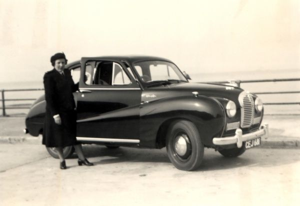 A lady and an Austin A40 by the sea