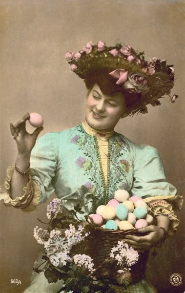A lady with a basket full of decorated Easter eggs
