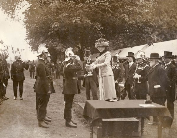 Lady Cheylesmore (Elizabeth Richardson French, d.1945) presenting the prizes at the Annual London Fire Brigade Display at Battersea Park, south west London