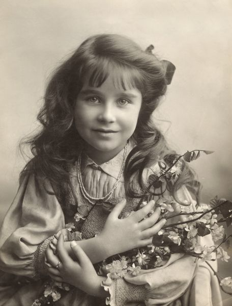 Lady Elizabeth Angela Marguerite Bowes-Lyon (1900-2002), later Duchess of York, Queen Elizabeth and then Queen Mother (to Queen Elizabeth II). Wife of King George VI. Pictured at the age of seven