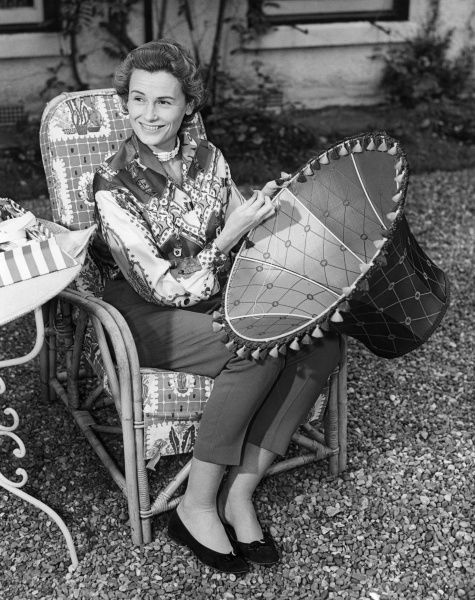 Lady Isobel Barnett (1918-1980) English radio and television star holding a lampshade