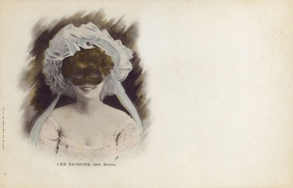 Lady at a Masked Ball displaying a toothy grin Date: circa 1904
