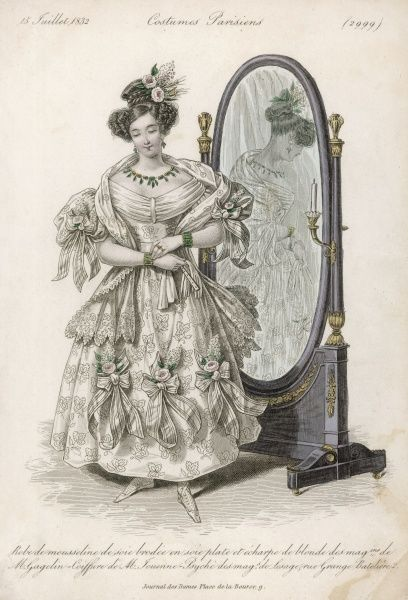 A Parisienne in a fine dress stands modestly before her mirror