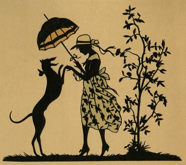 A lady with a parasol and her dog, standing in a garden.  20th century