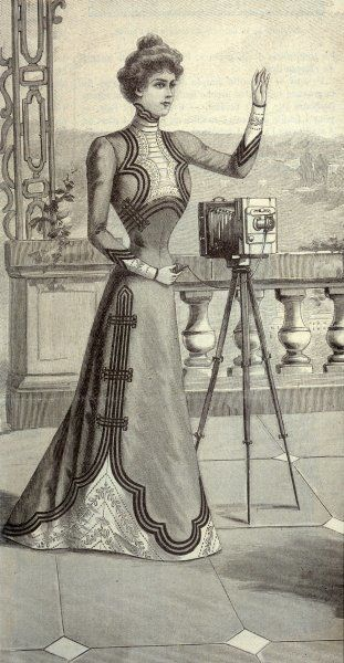 A well-dressed lady with her tripod-mounted camera