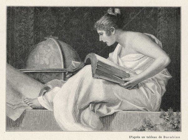 A lady with her feet up reads a heavy book