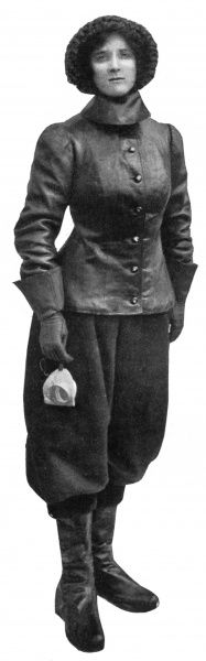 An early lady's aviation suit designed by Messrs Dunhill to exclude the cold. The costume comprises a divided leather skirt, the extremities of which are tucked into the tops of high button boots and a leather jacket. Date: 1909