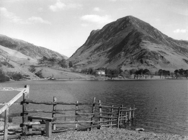 A view across Lake Buttermere, the Lake District, Cumbria, England, with the mass that is Fleetwith Pike and Kirkstone Pass to its left. Date: 1960s