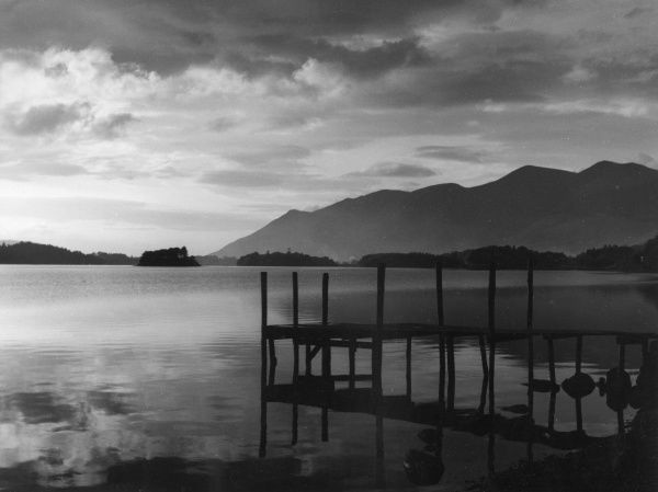 Evening falls over Derwentwater, Lake District, Cumbria, England. Date: 1950s