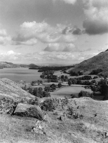 Looking along Lake Ullswater, towards Pooley Bridge, from Martindale House, Westmorland, England. Date: 1960s