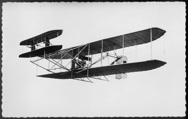 Le comte de Lambert makes the first aeroplane flight over Paris, rounding the Tour d'Eiffel in this Wright biplane