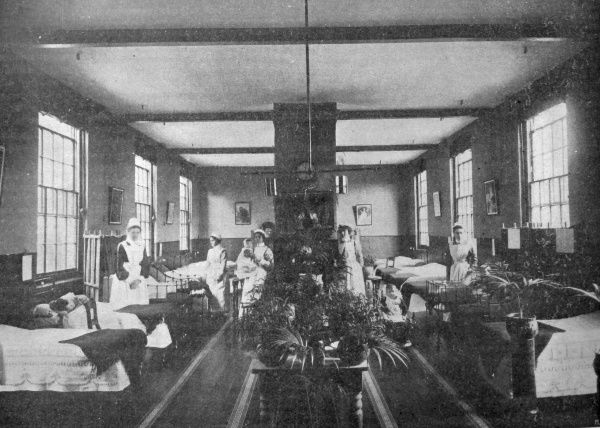 The parish of Lambeth operated a workhouse school on Elder Road, West Norwood. This interior view of a ward in the Schools' infirmary shows beds and cots and a few children and their nurses. Date: 1905