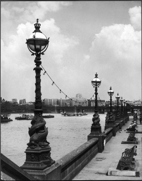A splendid row of graceful lamps outside County Hall, London